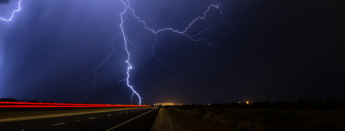 lightning striking on an empty highway