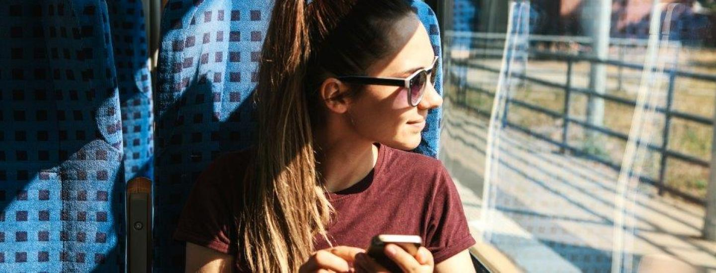 girl in sunglasses looking out window
