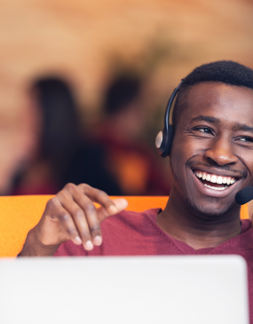 man on call in contact center smiling